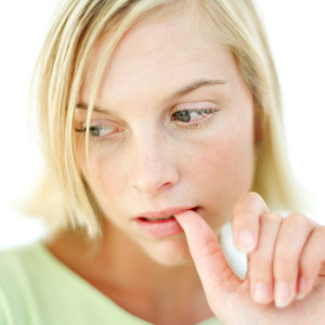 Young Woman Biting Her Finger Nail